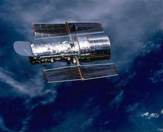 The Hubble Space Telescope (HST) is a telescope orbiting the Earth 370 miles above the atmosphere.