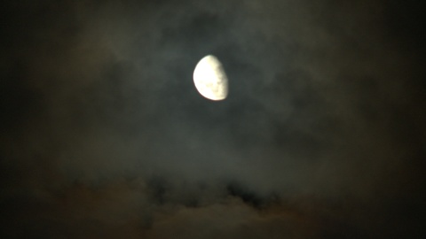 Moon on grey, cloudy sky