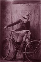 Woman exposing herself on a bike